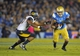 October 12, 2013; Pasadena, CA, USA; UCLA Bruins wide receiver Darius Bell (3) runs the ball against the California Golden Bears during the first half at the Rose Bowl. Mandatory Credit: Gary A. Vasquez-USA TODAY Sports