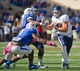 Oct 5, 2013; Tulsa, OK, USA; Rice Owls  running back Turner Petersen (26) gets past Tulsa Hurricanes defensive back Michael Mudoh (1) and linebacker DeWitt Jennings (27) during the first half of a game at Skelly Field at H.A. Chapman Stadium. Mandatory Credit: Beth Hall-USA TODAY Sports