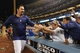 Oct 7, 2013; Los Angeles, CA, USA;  Los Angeles Dodgers first baseman Adrian Gonzalez (23) celebrates with fans after defeating the Atlanta Braves 3-2 in game four of the National League divisional series at Dodger Stadium. Dodgers won 4-3. Mandatory Credit: Jayne Kamin-Oncea-USA TODAY Sports