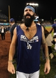 Oct 7, 2013; Los Angeles, CA, USA;  Los Angeles Dodgers relief pitcher Brian Wilson (00) celebrates with fans after defeating the Atlanta Braves 3-2 in game four of the National League divisional series at Dodger Stadium. Dodgers won 4-3. Mandatory Credit: Jayne Kamin-Oncea-USA TODAY Sports