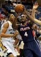 Oct 13, 2013; Biloxi, MS, USA; Atlanta Hawks power forward Paul Millsap (4) drives to the basket by New Orleans Pelicans power forward Anthony Davis (23) during the first half of their game at the Mississippi Coast Coliseum. Mandatory Credit: Chuck Cook-USA TODAY Sports