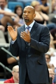 Oct 13, 2013; Biloxi, MS, USA; New Orleans Pelicans head coach Monty Williams claps for his team during the first half of their game against the Atlanta Hawks at the Mississippi Coast Coliseum. Mandatory Credit: Chuck Cook-USA TODAY Sports