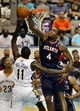 Oct 13, 2013; Biloxi, MS, USA; Atlanta Hawks power forward Paul Millsap (4) blocks a shot by New Orleans Pelicans point guard Jrue Holiday (11) during the first half of their game at the Mississippi Coast Coliseum. Mandatory Credit: Chuck Cook-USA TODAY Sports