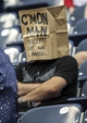 Oct 13, 2013; Houston, TX, USA; A Houston Texans fan watches with a bag over his head during the fourth quarter of a game against the St. Louis Rams at Reliant Stadium. Mandatory Credit: Troy Taormina-USA TODAY Sports