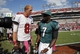 Oct 13, 2013; Tampa, FL, USA; Tampa Bay Buccaneers quarterback Mike Glennon (8) and Philadelphia Eagles quarterback Michael Vick (7) talk at the end of the game at Raymond James Stadium. Philadelphia Eagles defeated the Tampa Bay Buccaneers 31-20. Mandatory Credit: Kim Klement-USA TODAY Sports