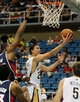 Oct 13, 2013; Biloxi, MS, USA; New Orleans Pelicans shooting guard Austin Rivers (25) shoots around Atlanta Hawks power forward Elton Brand (42) during the second half of their game at the Mississippi Coast Coliseum. The Pelicans won 105-73. Mandatory Credit: Chuck Cook-USA TODAY Sports