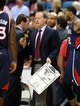 Oct 13, 2013; Biloxi, MS, USA; Atlanta Hawks head coach Mike Budenholzer talks to his players during the second half of their game against the New Orleans Pelicans at the Mississippi Coast Coliseum. The Pelicans won 105-73. Mandatory Credit: Chuck Cook-USA TODAY Sports