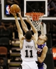 Oct 13, 2013; San Antonio, TX, USA; San Antonio Spurs forward Jeff Ayres (11) has his shot blocked by Phoenix Suns center Alex Len (right) during the second half at AT&T Center. The Suns won 106-99. Mandatory Credit: Soobum Im-USA TODAY Sports