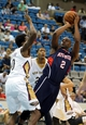 Oct 13, 2013; Biloxi, MS, USA; Atlanta Hawks shooting guard Damien Wilkins (2) shoots over New Orleans Pelicans small forward Al-Farouq Aminu (0) during the first half of their game at the Mississippi Coast Coliseum. Mandatory Credit: Chuck Cook-USA TODAY Sports