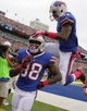 Oct 13, 2013; Orchard Park, NY, USA; Buffalo Bills wide receiver Marquise Goodwin (88) and wide receiver T.J. Graham (11) celebrate a second half touchdown against the Cincinnati Bengals at Ralph Wilson Stadium. Bengals beat the Bills 27 to 24 in overtime.  Mandatory Credit: Timothy T. Ludwig-USA TODAY Sports