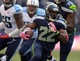 Oct 13, 2013; Seattle, WA, USA; Seattle Seahawks running back Robert Turbin (22) carries the ball against the Tennessee Titans at CenturyLink Field. The Seahawks defeated the Titans 20-13. Mandatory Credit: Kirby Lee-USA TODAY Sports