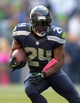 Oct 13, 2013; Seattle, WA, USA; Seattle Seahawks running back Marshawn Lynch (24) carries the ball against the Tennessee Titans at CenturyLink Field. Mandatory Credit: Kirby Lee-USA TODAY Sports