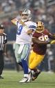 Oct 13, 2013; Arlington, TX, USA; Dallas Cowboys quarterback Tony Romo (9) throws in the pocket against the Washington Redskins at AT&T Stadium. Mandatory Credit: Matthew Emmons-USA TODAY Sports