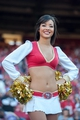 Oct 13, 2013; San Francisco, CA, USA; A San Francisco 49ers cheerleader smiles for the camera during the fourth quarter of the game against the Arizona Cardinals at Candlestick Park. The San Francisco 49ers defeated the Arizona Cardinals 32-20. Mandatory Credit: Ed Szczepanski-USA TODAY Sports