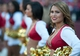 Oct 13, 2013; San Francisco, CA, USA; A San Francisco 49ers cheerleader looks on during the fourth quarter of the game against the Arizona Cardinals at Candlestick Park. The San Francisco 49ers defeated the Arizona Cardinals 32-20. Mandatory Credit: Ed Szczepanski-USA TODAY Sports