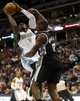 Oct 14, 2013; Denver, CO, USA;  Denver Nuggets forward J.J. Hickson (7) drives to the basket during the first half against the San Antonio Spurs at Pepsi Center. Mandatory Credit: Chris Humphreys-USA TODAY Sports