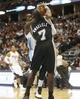 Oct 14, 2013; Denver, CO, USA;  Denver Nuggets forward J.J. Hickson (7) drives to the basket against San Antonio Spurs forward Dan Nwaelele (7) during the first half at Pepsi Center. Mandatory Credit: Chris Humphreys-USA TODAY Sports