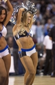 Oct 14, 2013; Dallas, TX, USA; A Dallas Mavericks dancer performs during a timeout in the game between the Mavericks and the Orlando Magic  at American Airlines Center. The Magic defeated the Mavericks 102-94. Mandatory Credit: Jerome Miron-USA TODAY Sports
