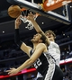 Oct 14, 2013; Denver, CO, USA; San Antonio Spurs forward Tiago Splitter (22) is fouled as he drives to the basket by Denver Nuggets center Timofey Mozgov (25) during the second half at Pepsi Center. The Nuggets won 98-94. Mandatory Credit: Chris Humphreys-USA TODAY Sports