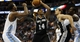 Oct 14, 2013; Denver, CO, USA; San Antonio Spurs forward Corey Maggette (14) drives to the basket during the second half against the Denver Nuggets at Pepsi Center. The Nuggets won 98-94. Mandatory Credit: Chris Humphreys-USA TODAY Sports