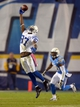 Oct 14, 2013; San Diego, CA, USA; Indianapolis Colts receiver Reggie Wayne (87) attempts to catch a pass in the fourth quarter as San Diego Chargers cornerback Marcus Gilchrist (38) at Qualcomm Stadium. The Chargers defeated the Colts 19-9. Mandatory Credit: Kirby Lee-USA TODAY Sports