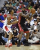 Oct 15, 2013; Washington, DC, USA; Miami Heat small forward LeBron James (6) looks to pass as Washington Wizards small forward Trevor Ariza (1) defends during the first half at the Verizon Center. Mandatory Credit: Brad Mills-USA TODAY Sports