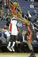 Oct 15, 2013; Washington, DC, USA; Washington Wizards point guard John Wall (2) shoots a jump shot over Miami Heat small forward LeBron James (6) during the first half at the Verizon Center. Mandatory Credit: Brad Mills-USA TODAY Sports