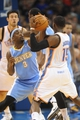 Oct 15, 2013; Oklahoma City, OK, USA; Denver Nuggets point guard Ty Lawson (3) fights for the ball against Oklahoma City Thunder point guard Reggie Jackson (15) during the second quarter at Chesapeake Energy Arena. Mandatory Credit: Mark D. Smith-USA TODAY Sports
