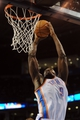Oct 15, 2013; Oklahoma City, OK, USA; Oklahoma City Thunder power forward Serge Ibaka (9) attempts to dunk the ball against the Denver Nuggets during the third quarter at Chesapeake Energy Arena. Mandatory Credit: Mark D. Smith-USA TODAY Sports