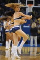 Oct 15, 2013; Oklahoma City, OK, USA; A member of the Oklahoma City Thunder dance team entertains the crowd in a break in action against the Denver Nuggets during the fourth quarter at Chesapeake Energy Arena. Mandatory Credit: Mark D. Smith-USA TODAY Sports
