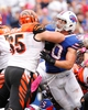 Oct 13, 2013; Orchard Park, NY, USA; Cincinnati Bengals guard Clint Boling (65) blocks Buffalo Bills middle linebacker Kiko Alonso (50) during the second half at Ralph Wilson Stadium. Bengals beat the Bills 27-24 in overtime. Mandatory Credit: Kevin Hoffman-USA TODAY Sports
