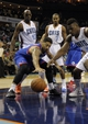 Oct 17, 2013; Charlotte, NC, USA; Philadelphia 76ers forward Royce White (30) and Charlotte Bobcats forward Jeff Adrien (4) go after a loose ball during the pre season game at Time Warner Cable Arena. Mandatory Credit: Sam Sharpe-USA TODAY Sports