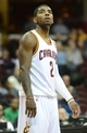 Oct 17, 2013; Cleveland, OH, USA; Cleveland Cavaliers point guard Kyrie Irving (2) looks up at the scoreboard during the game against the Detroit Pistons at Quicken Loans Arena. Mandatory Credit: Eric P. Mull-USA TODAY Sports
