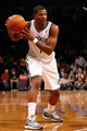 Oct 17, 2013; Brooklyn, NY, USA;  Brooklyn Nets shooting guard Joe Johnson (7) passes the ball during the third quarter against the Miami Heat at Barclays Center. Brooklyn won 86-62.  Mandatory Credit: Anthony Gruppuso-USA TODAY Sports
