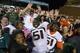 Oct 17, 2013; Chapel Hill, NC, USA; Miami Hurricanes defensive lineman Shayon Green (51) celebrates with fans  after the game. The Miami Hurricanes defeated the North Carolina Tar Heels 27-23 at Kenan Memorial Stadium. Mandatory Credit: Bob Donnan-USA TODAY Sports