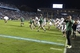 Oct 17, 2013; Chapel Hill, NC, USA; Miami Hurricanes head coach Al Golden (left) leads the team across the field after the game. The Miami Hurricanes defeated the North Carolina Tar Heels 27-23 at Kenan Memorial Stadium. Mandatory Credit: Bob Donnan-USA TODAY Sports
