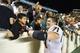 Oct 17, 2013; Chapel Hill, NC, USA; Miami Hurricanes defensive lineman Anthony Chickillo (71) celebrates with fans after the game. The Miami Hurricanes defeated the North Carolina Tar Heels 27-23 at Kenan Memorial Stadium. Mandatory Credit: Bob Donnan-USA TODAY Sports