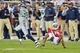 Oct 17, 2013; Phoenix, AZ, USA; Seattle Seahawks cornerback Brandon Browner (39) intercepts a pass intended for Arizona Cardinals wide receiver Michael Floyd (15) during the second half at University of Phoenix Stadium. Mandatory Credit: Matt Kartozian-USA TODAY Sports