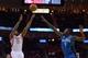 Oct 16, 2013; Houston, TX, USA; Houston Rockets shooting guard Reggie Williams (55) shoots over Orlando Magic shooting guard Victor Oladipo (5) during the second half at Toyota Center. The Rockets won 108-104. Mandatory Credit: Thomas Campbell-USA TODAY Sports