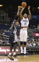 Oct 18, 2013; Orlando, FL, USA; Orlando Magic point guard Jameer Nelson (14) shoots over Memphis Grizzlies point guard Mike Conley (11) during the second half at Amway Center. Memphis Grizzlies defeated the Orlando Magic 97-91. Mandatory Credit: Kim Klement-USA TODAY Sports