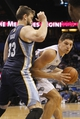Oct 18, 2013; Orlando, FL, USA; Orlando Magic center Nikola Vucevic (9) drives to the basket as Memphis Grizzlies center Marc Gasol (33) defends during the second half at Amway Center. Memphis Grizzlies defeated the Orlando Magic 97-91. Mandatory Credit: Kim Klement-USA TODAY Sports