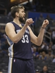 Oct 18, 2013; Orlando, FL, USA; Memphis Grizzlies center Marc Gasol (33) calls a play against the Orlando Magic during the second half at Amway Center. Memphis Grizzlies defeated the Orlando Magic 97-91. Mandatory Credit: Kim Klement-USA TODAY Sports