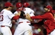 Oct 18, 2013; St. Louis, MO, USA; St. Louis Cardinals players David Freese (23) , Yadier Molina (middle) and Trevor Rosenthal (facing forward) celebrate after game six of the National League Championship Series baseball game against the Los Angeles Dodgers at Busch Stadium. Mandatory Credit: Jeff Curry-USA TODAY Sports