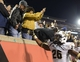 Oct 18, 2013; Louisville, KY, USA; UCF Knights defensive back Clayton Geathers (26) celebrates with the fans after defeating the Louisville Cardinals in the second half of play at Papa John's Cardinal Stadium. Central Florida defeated Louisville 38-35.  Mandatory Credit: Jamie Rhodes-USA TODAY Sports