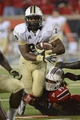 Oct 18, 2013; Louisville, KY, USA; UCF Knights running back William Stanback (28) tries to escape the tackle of Louisville Cardinals defensive end Lorenzo Mauldin (94) during the second half of play at Papa John's Cardinal Stadium. Central Florida defeated Louisville 38-35.  Mandatory Credit: Jamie Rhodes-USA TODAY Sports