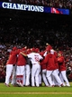 Oct 18, 2013; St. Louis, MO, USA; Members of the St. Louis Cardinals celebrate on the field after game six of the National League Championship Series baseball game against the Los Angeles Dodgers at Busch Stadium. Mandatory Credit: Scott Rovak-USA TODAY Sports