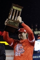 Oct 18, 2013; St. Louis, MO, USA; St. Louis Cardinals manager Mike Matheny hoists the National League championship trophy after game six of the National League Championship Series baseball game against the Los Angeles Dodgers at Busch Stadium. Mandatory Credit: David J. Phillip/Pool Photo via USA TODAY Sports