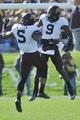 Oct 19, 2013; Evanston, IL, USA; Minnesota Golden Gophers linebacker James Manuel (9)  celebrates his sack with linebacker Damien Wilson (5) against the Northwestern Wildcats at Ryan Field. Mandatory Credit: David Banks-USA TODAY Sports