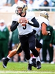 Oct 19, 2013; East Lansing, MI, USA; Purdue Boilermakers quarterback Danny Etling (5) scrambles from pocket during the 1st  half of game against the Michigan State Spartans at Spartan Stadium. Mandatory Credit: Mike Carter-USA TODAY Sports