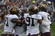 Oct 19, 2013; Evanston, IL, USA;  Minnesota Golden Gophers linebacker James Manuel (9)  is congratulated by his teammates after running back an interception for a touchdown against the Northwestern Wildcats during the second half at Ryan Field.  The Minnesota Golden Gophers defeated the Northwestern Wildcats 20-17. Mandatory Credit: David Banks-USA TODAY Sports